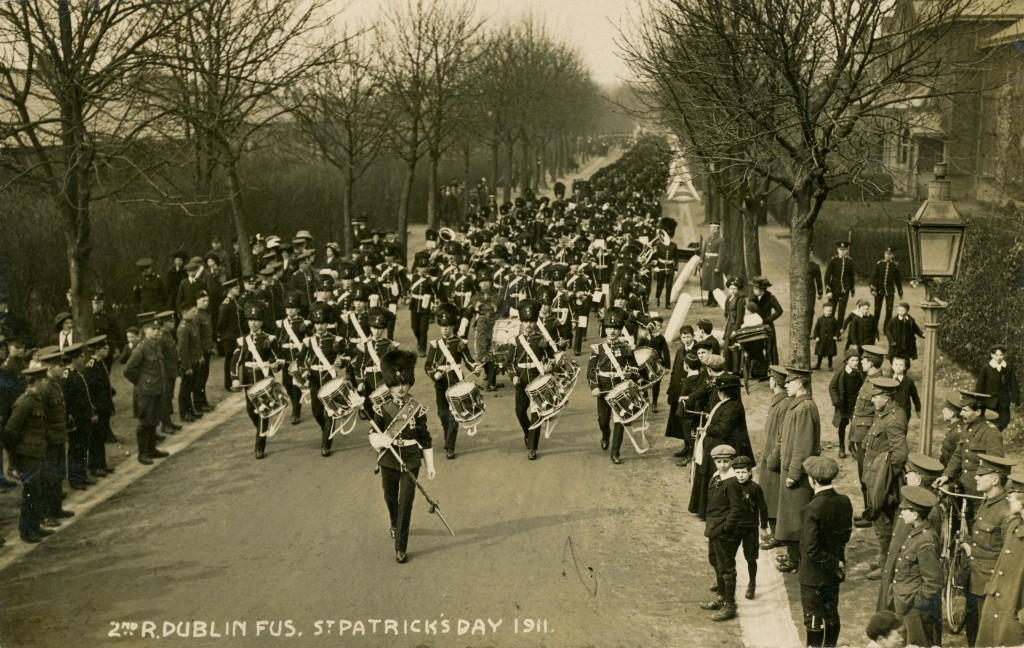The 2nd Battalion of the regiment marching on St. Patrick's Day 1911. This image was produced as part of a series of postcards. Another part is seen below