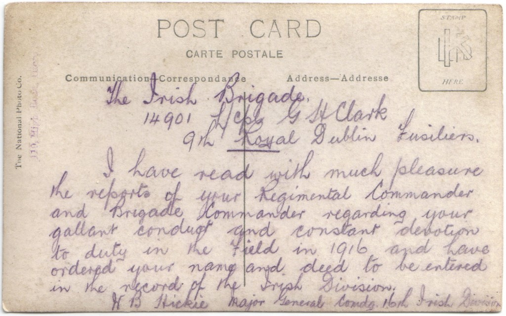 The reverse of a postcard with a transcript of a Divisional recomendation awarded to Clark
