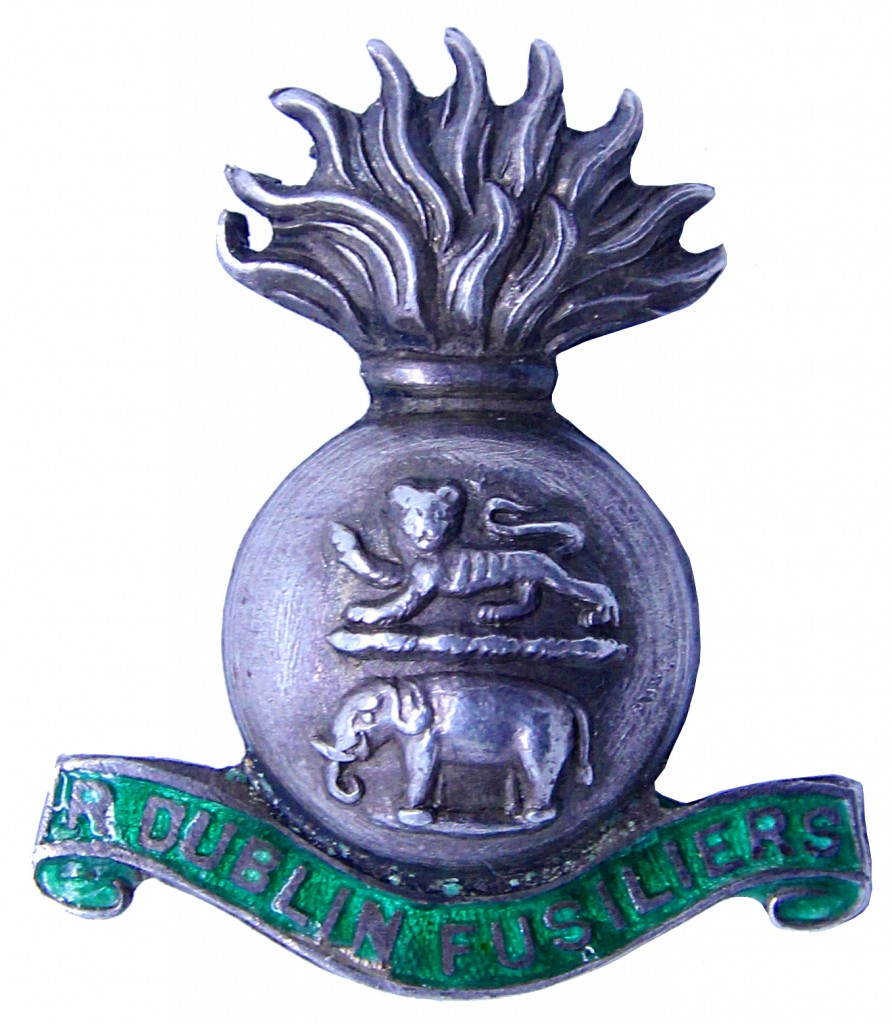 White metal and green enamel badge, noticeably omitting the word 'Royal' from the title of the regiment.