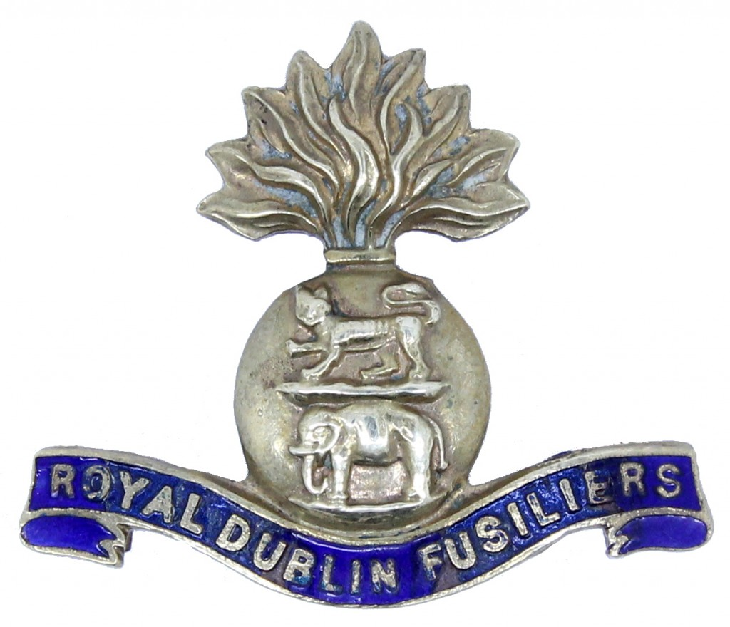 Metal and blue enamel badge in the form of the regimental cap badge